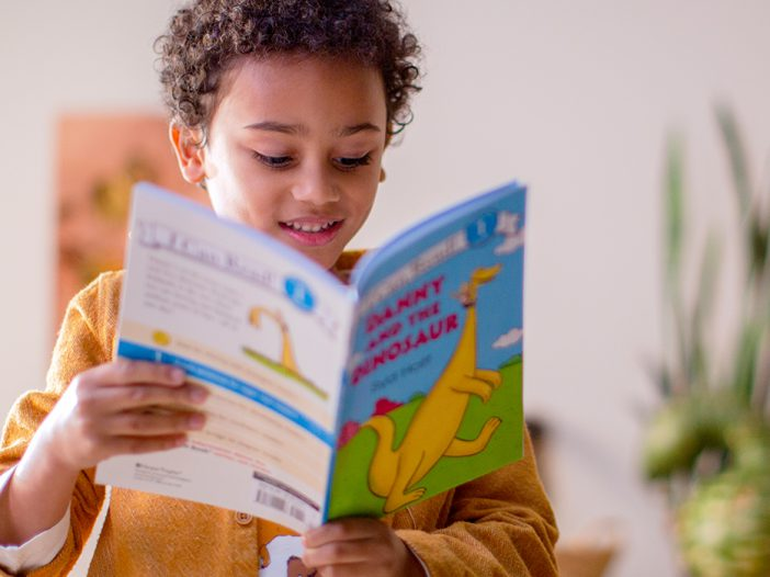 A child is reading a book
