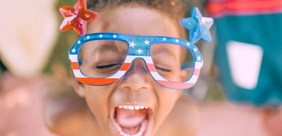 young child with American flag sunglasses for the Fourth of July