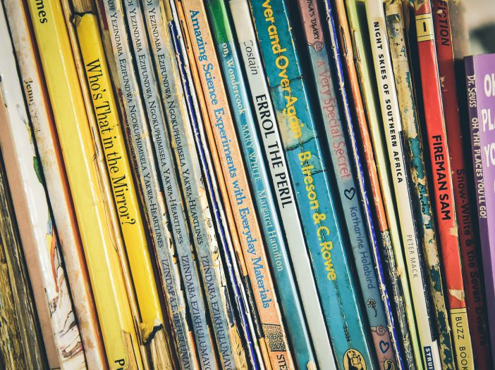 children's books lined up on a shelf