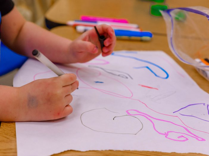 a child drawing shapes