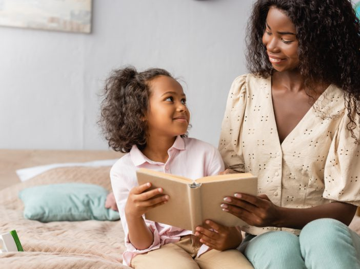 Mom helping daughter with reading
