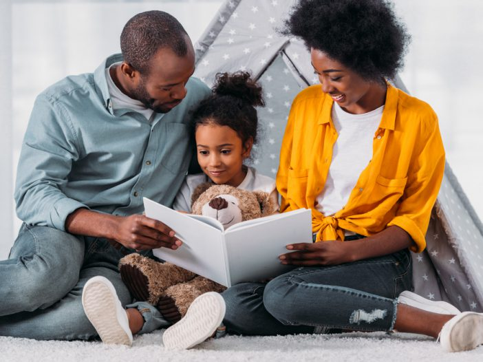 Parents teaching daughter sight words