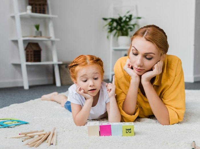 mom helping daughter with letter-sound correspondence