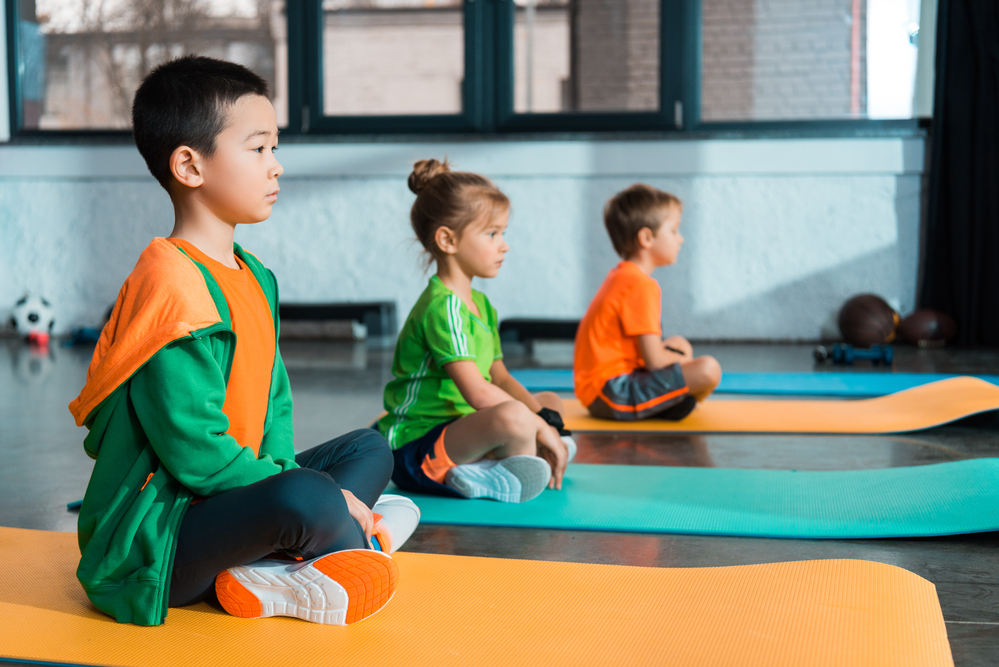 Young children learning meditation for kids