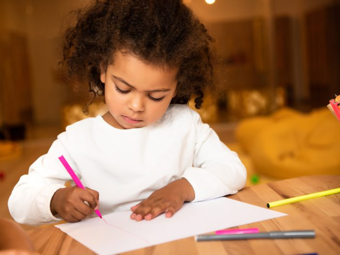 Young child working on number recognition