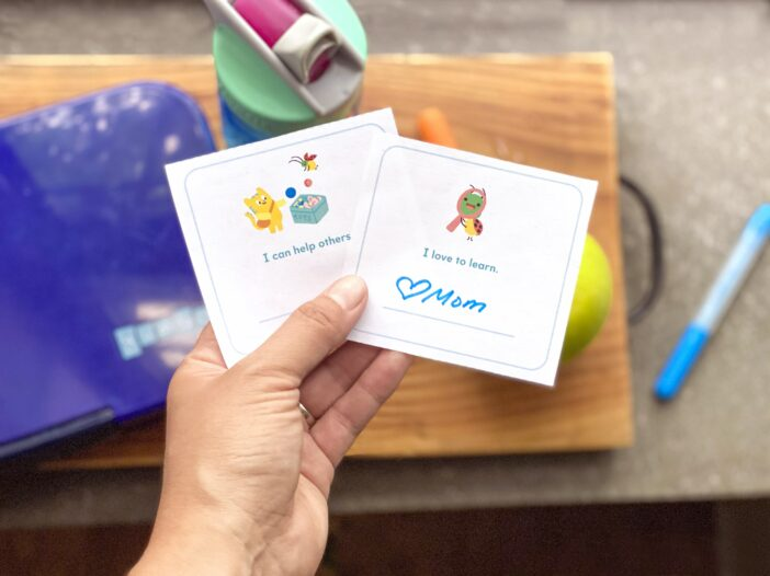 free lunchbox printable held in a parent's hand over a child's lunch