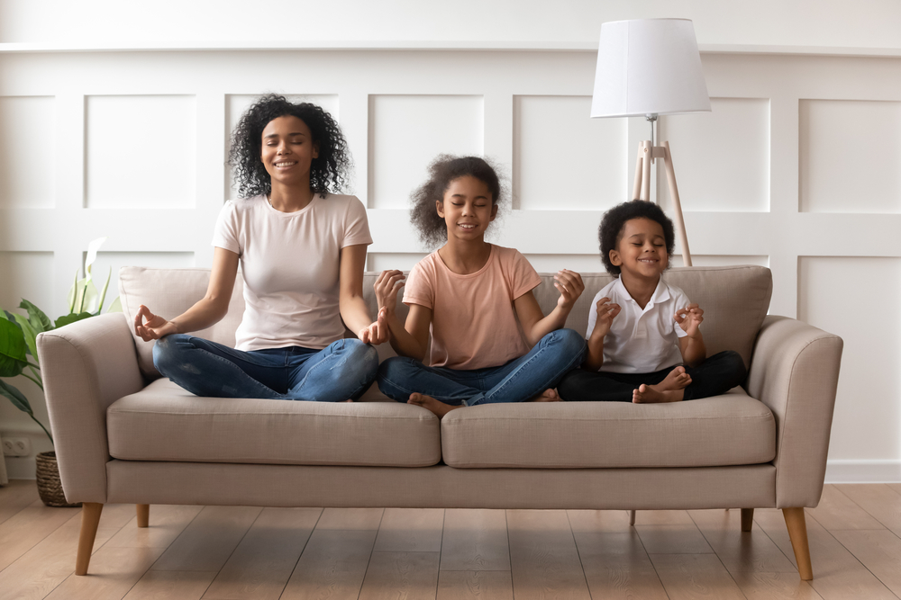 Family sitting on couch learning calming strategies for kids