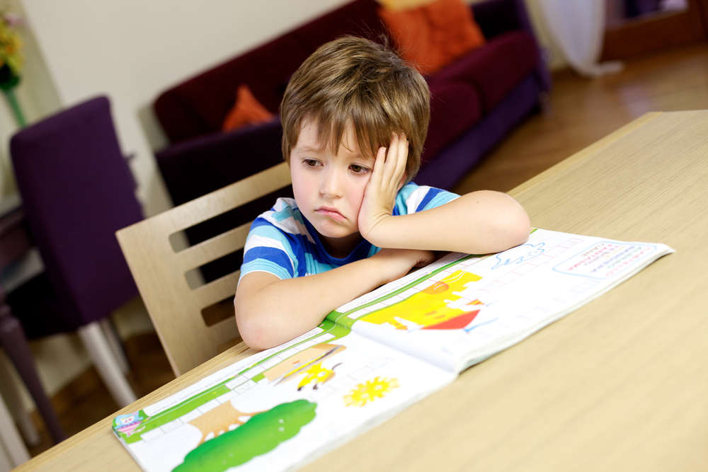 Young boy stressed who needs calming strategies for kids