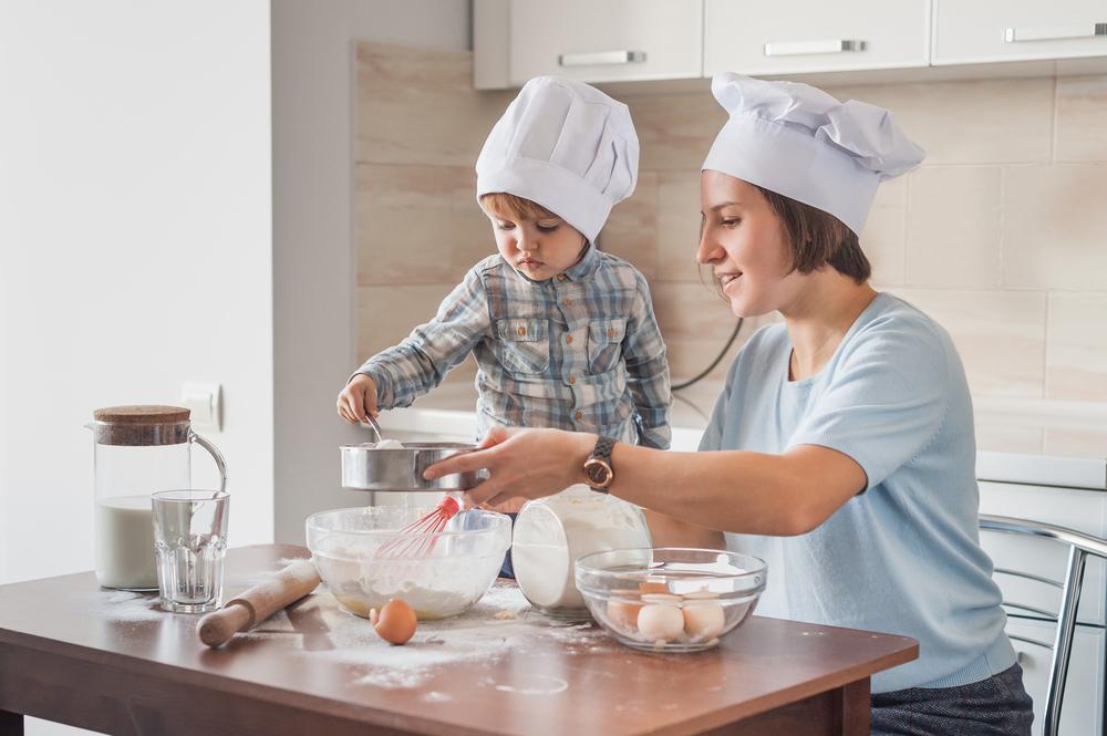 Mom teaching son how to bake
