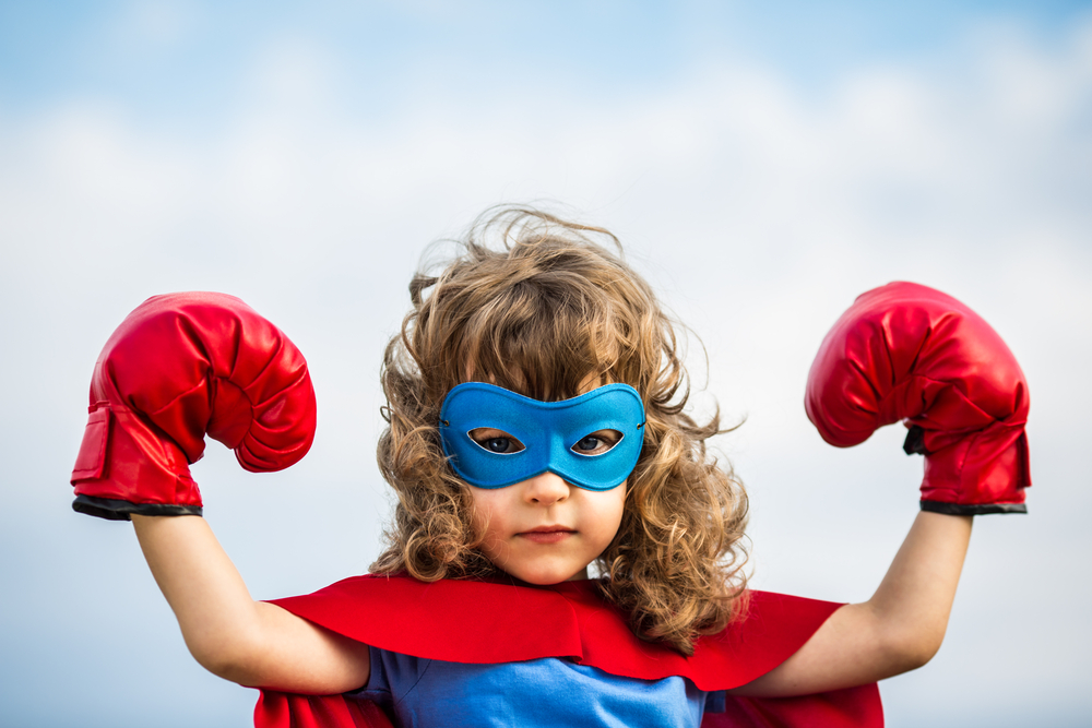 Young girl dressed up as a super hero boxer