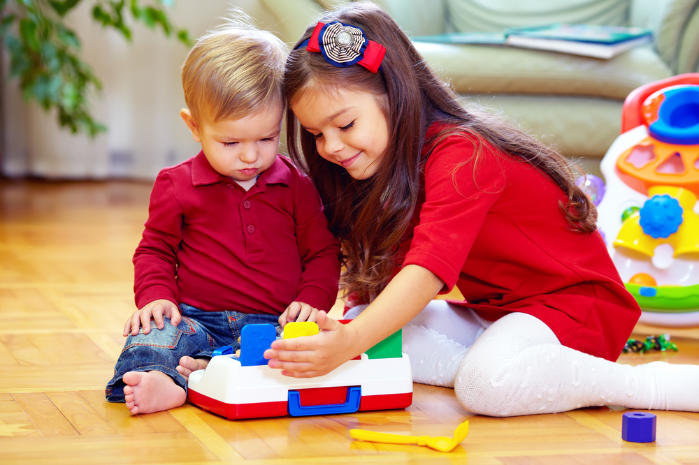 Two kids playing appropriate activities for 2-year-olds