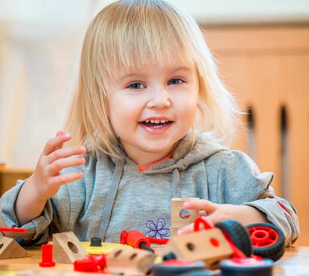 Young girl playing blocks