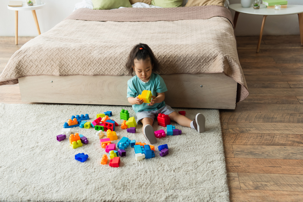 Young girl playing with lego blocks