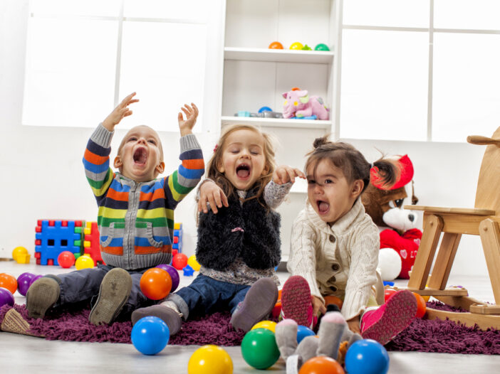 Three kids playing activities for 3-year-olds