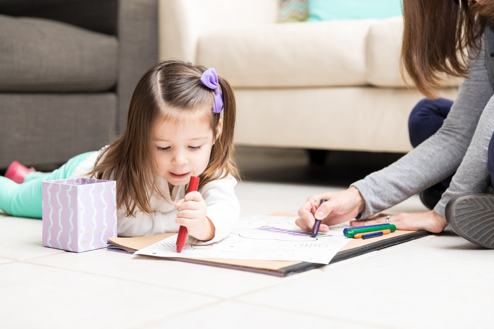 Mom coloring with daughter