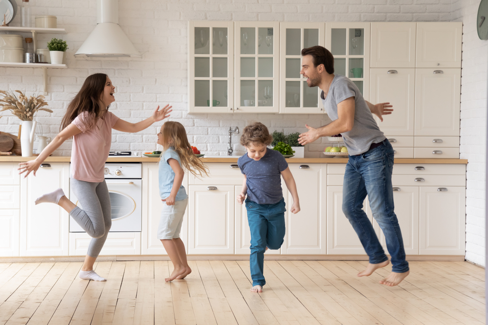 Parents with children dancing while taking brain breaks