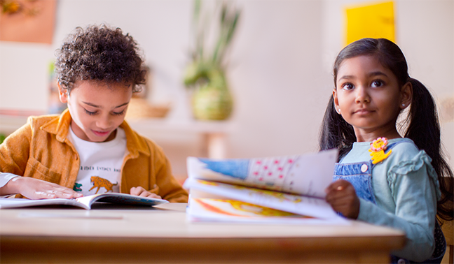 two kids doing school work