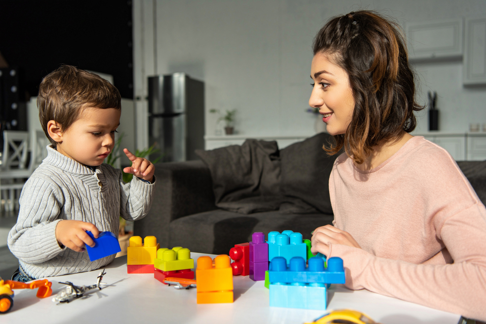 Mom teaching colors for kids to her son