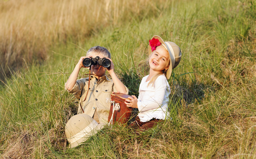 Kids dressed up in safari gear during dramatic play