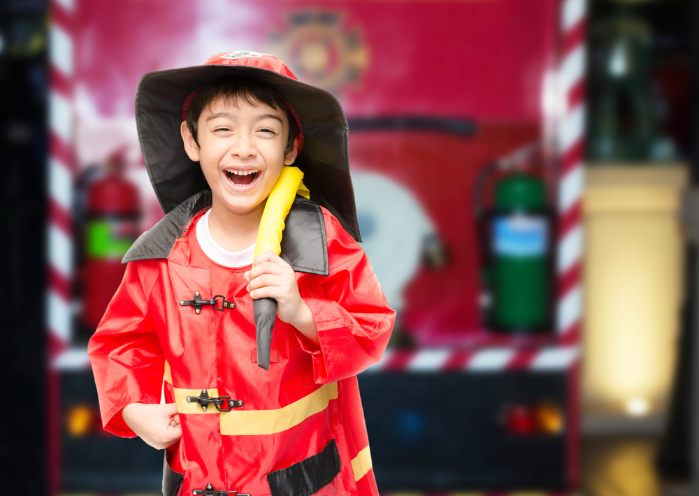 Young boy playing firefighter