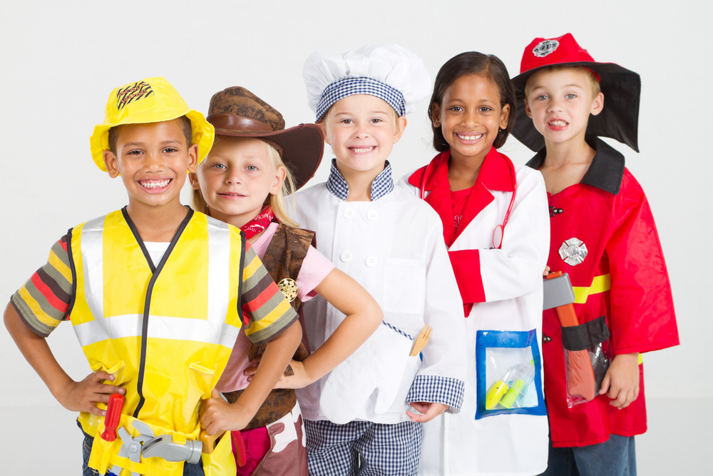 group of kids in uniforms costumes