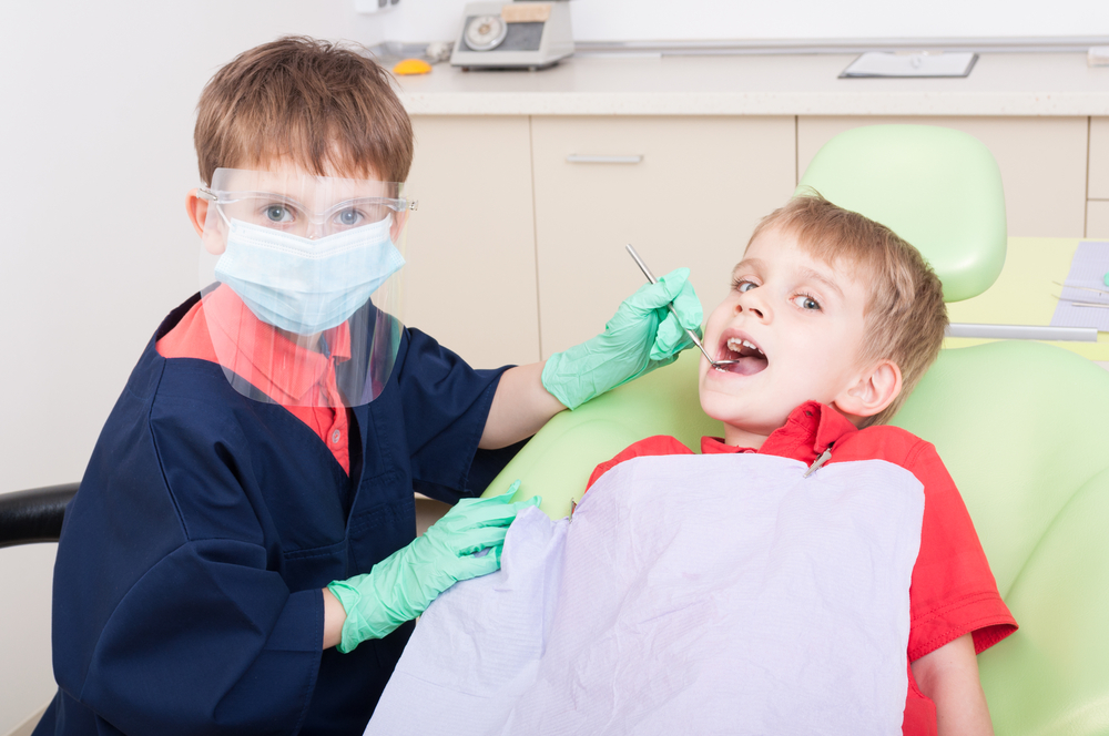 Kids doing dramatic play as a dentist and patient
