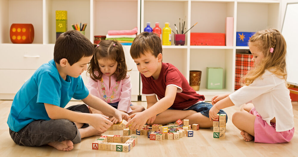 Children learning through play with blocks