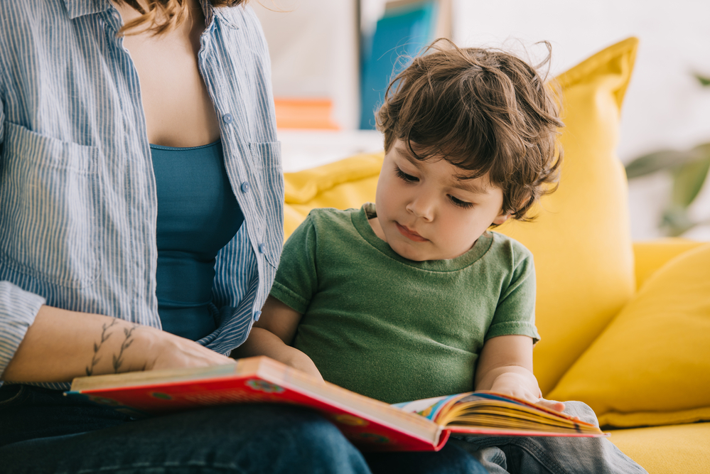 Mom with child helping him with sentences