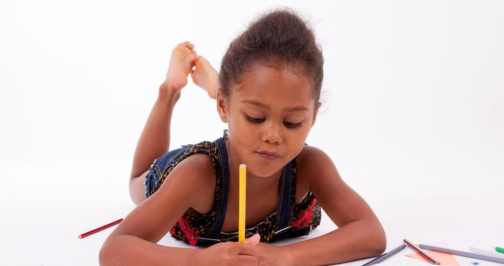 Little girl doing her studies