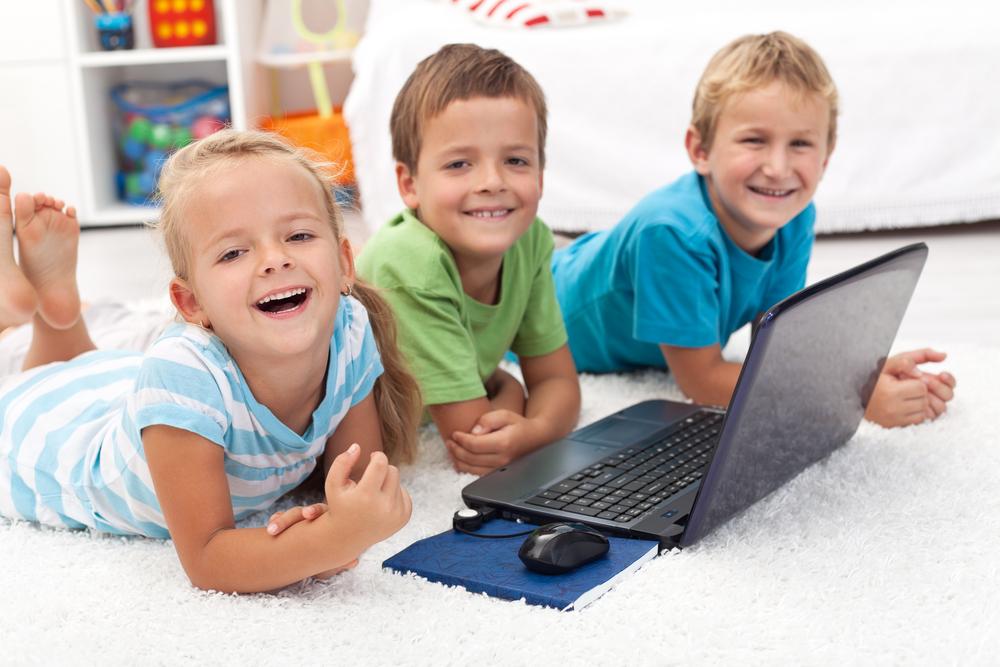Three kids working on a laptop