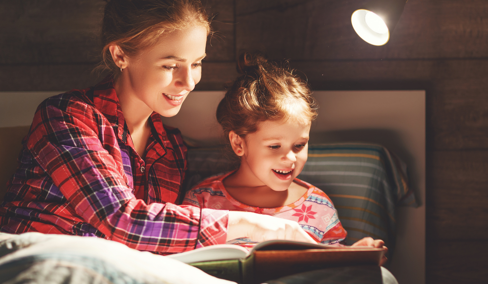 Mom reading to daughter to help with vocabulary