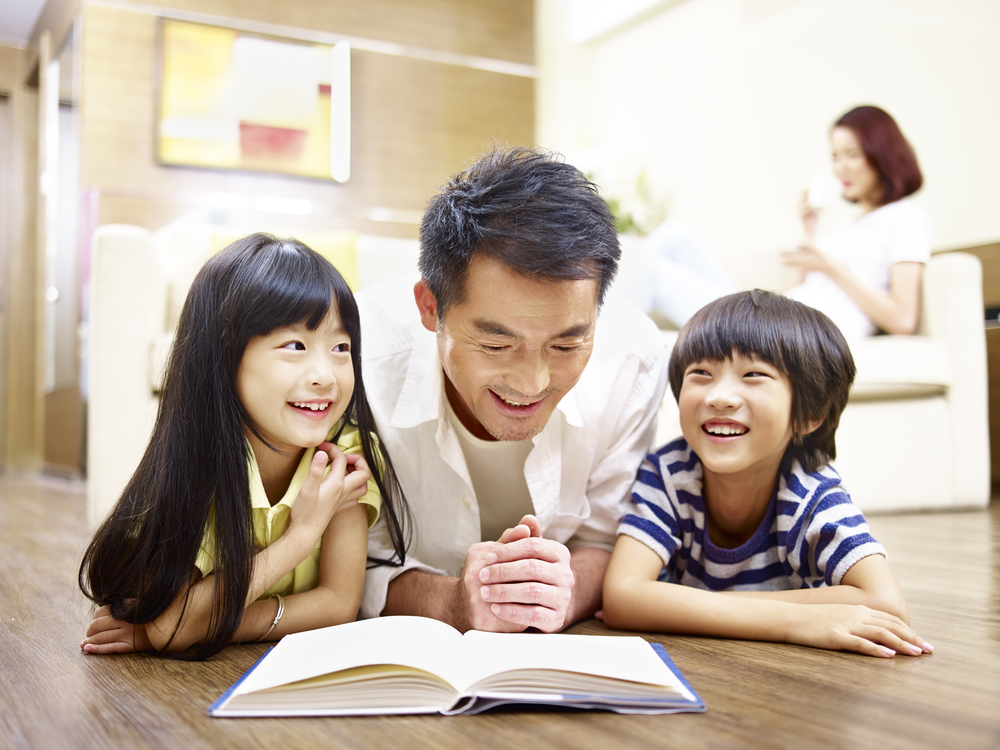 Dad reading with his kids