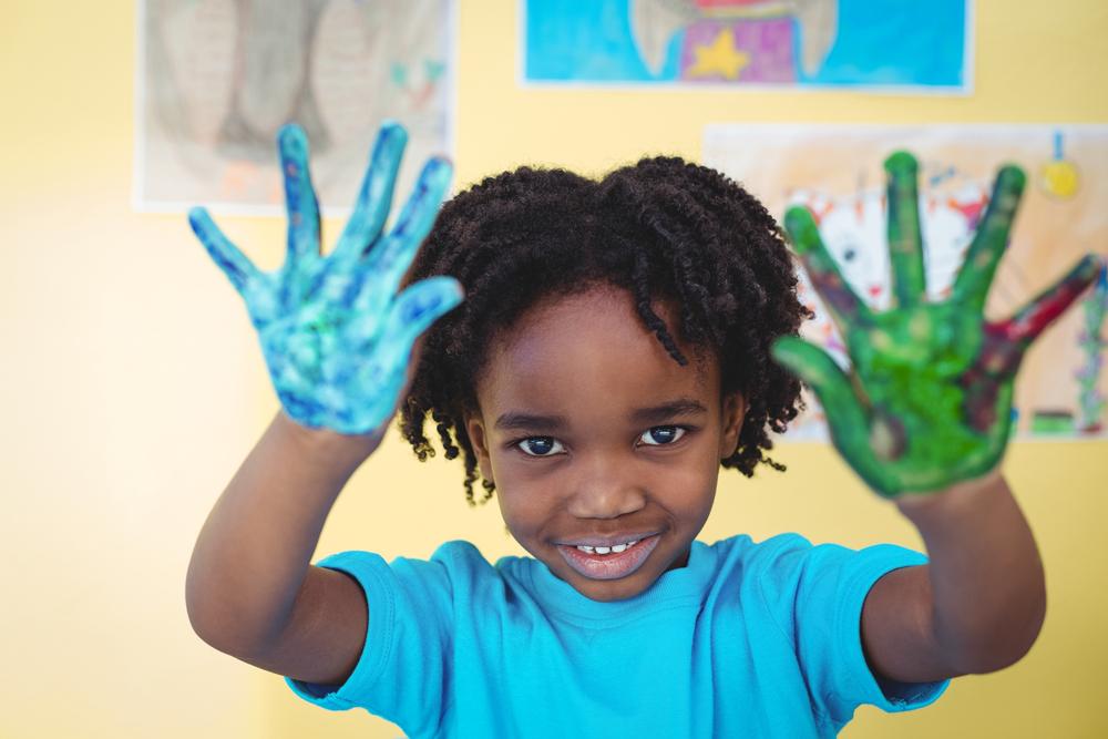 Kid doing finger painting