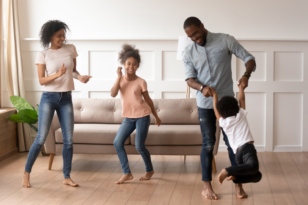 Family of four having a dance party