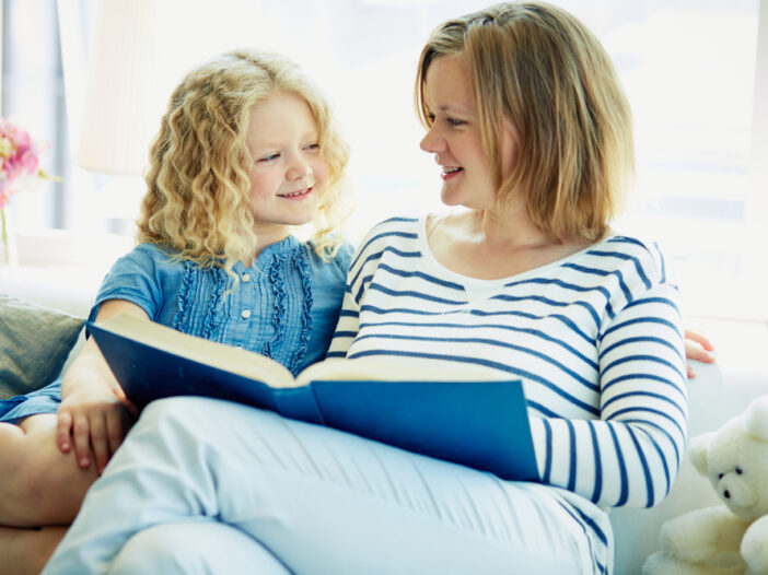 Mom reading to help her child learn adjectives