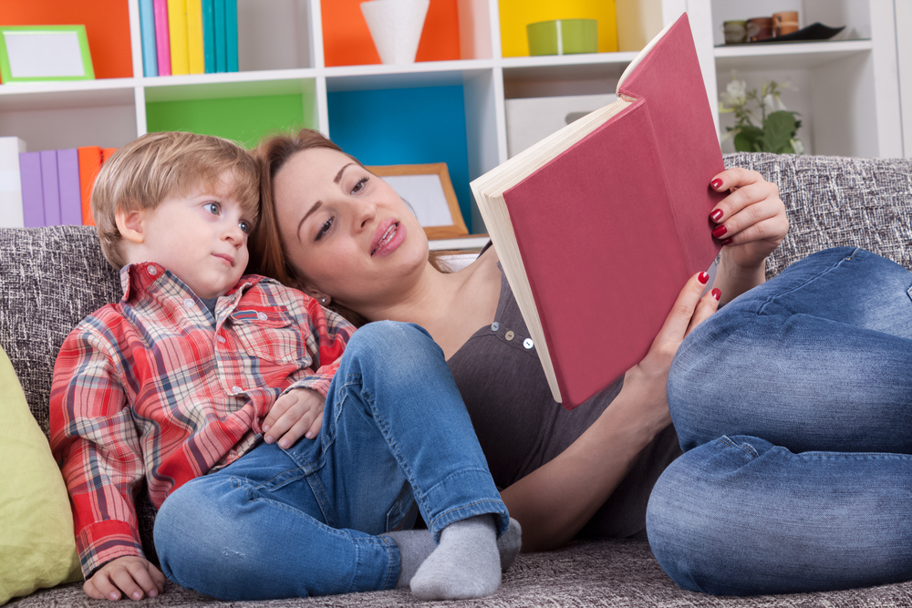 Mother and child reading a book to learn Adjectives For Kids