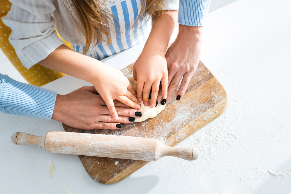 Cooking or baking with your child is great way to teach Cooperative Play