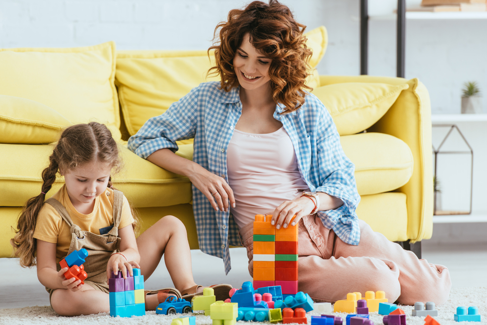 Mom teaching cooperative play to daughter