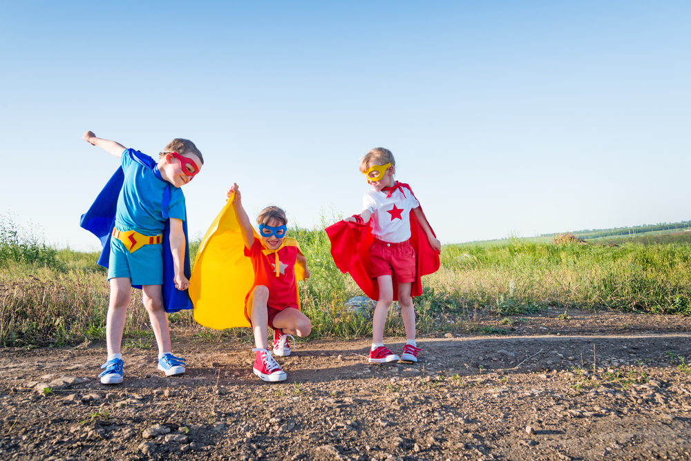 Kids doing cooperative play as super heroes