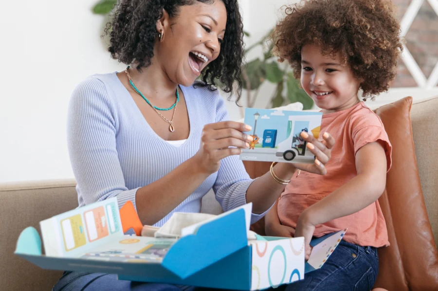 Mom opening up a box of creative activities for kids