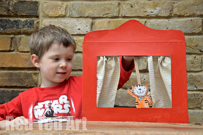 Young kid performing a puppet show