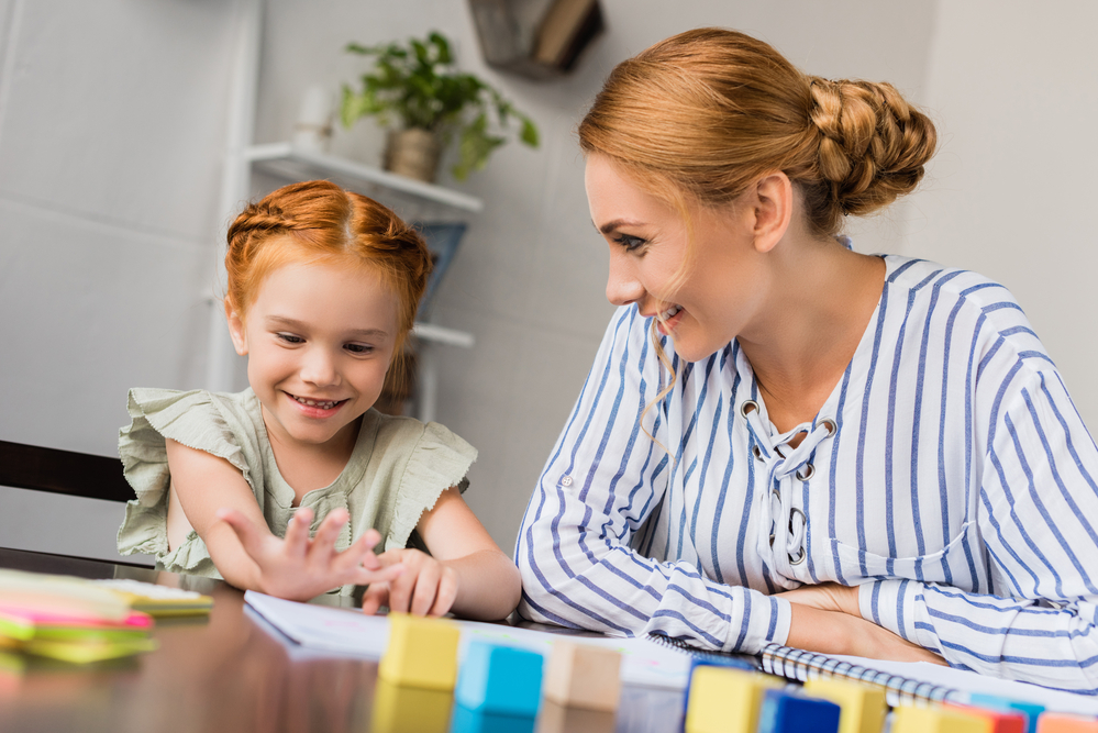 Mom teaching daughter first grade math