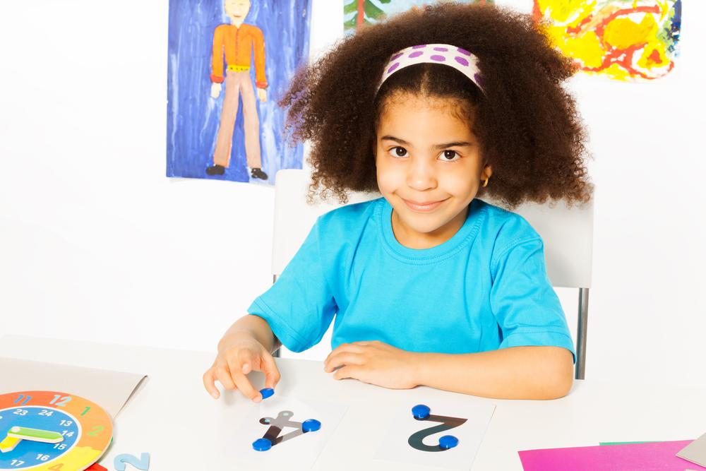 Girl learning first grade math