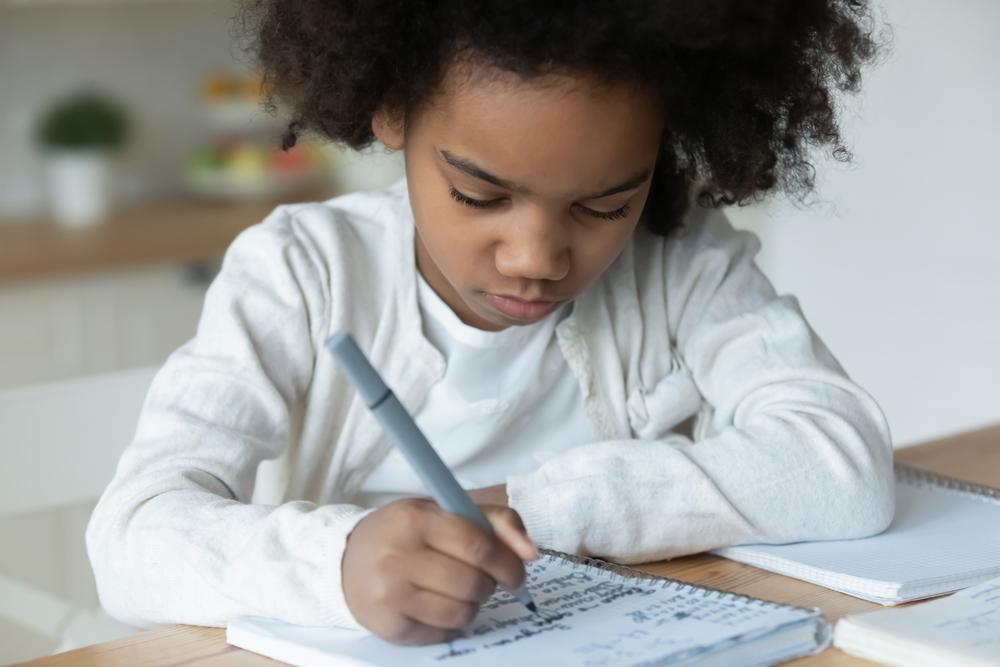 Young girl doing first grade math