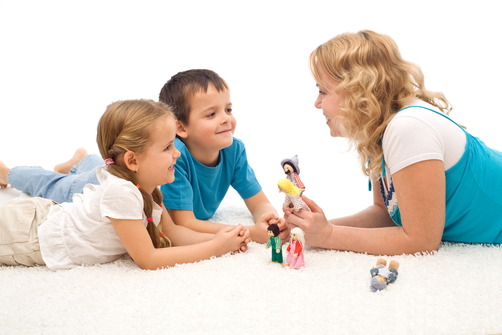 Mom teaching kids how to follow directions through a puppet show