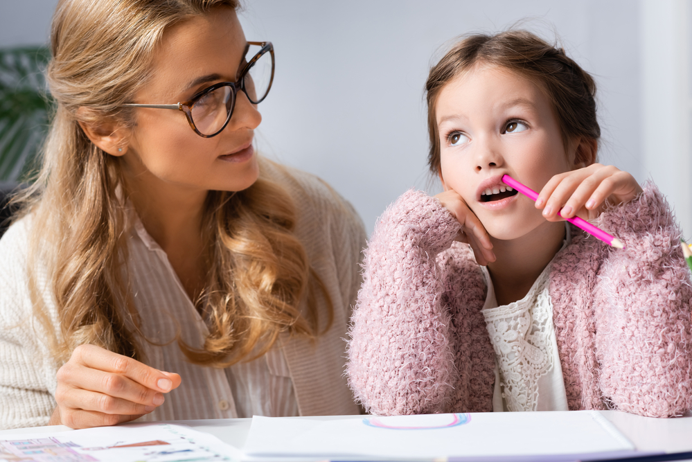 Mom with daughter helping with home work