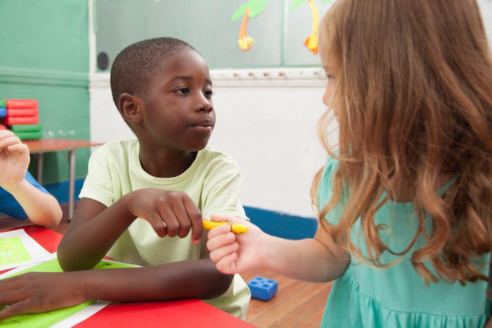 kids sharing a pen