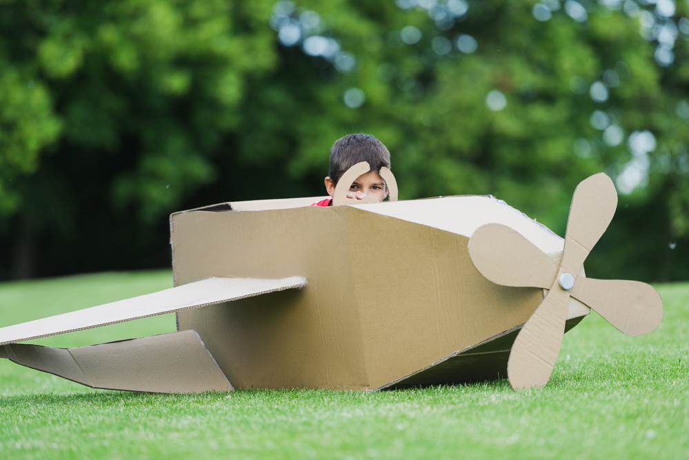Pretend play with a cardboard box
