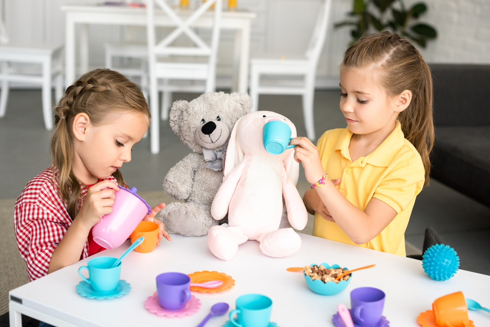 Pretend play tea party with stuffed animals