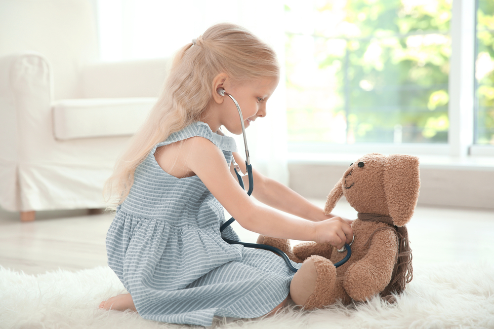 Pretend play with a stuffed bunny and stethoscope